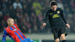 FC Barcelona's Lionel Messi and Viktoria's David Bystron (left)  fight for a ball during their Championship League group H match between FC Barcelona and Viktoria Plzen in Prague on November 1, 2011. AFP PHOTO/JOE KLAMAR / AFP PHOTO / JOE KLAMAR