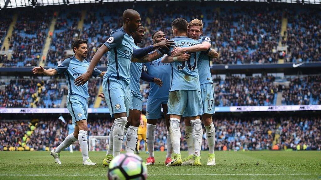 Manchester City's Argentinian defender Nicolas Otamendi (2R) is mobbed by teammates as he celebrates scoring his team's fifth goal during the English Premier League football match between Manchester City and Crystal Palace at the Etihad Stadium in Manchester, north west England, on May 6, 2017. Manchester City won the match 5-0. / AFP PHOTO / Oli SCARFF / RESTRICTED TO EDITORIAL USE. No use with unauthorized audio, video, data, fixture lists, club/league logos or 'live' services. Online in-match use limited to 75 images, no video emulation. No use in betting, games or single club/league/player publications.  /