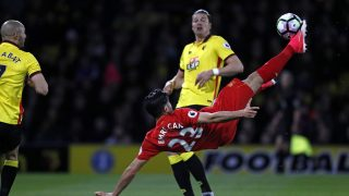 Liverpool's German midfielder Emre Can connects with this overhead kick to open the scoring in the English Premier League football match between Watford and Liverpool at Vicarage Road Stadium in Watford, north of London on May 1, 2017. / AFP PHOTO / Adrian DENNIS / RESTRICTED TO EDITORIAL USE. No use with unauthorized audio, video, data, fixture lists, club/league logos or 'live' services. Online in-match use limited to 75 images, no video emulation. No use in betting, games or single club/league/player publications.  /