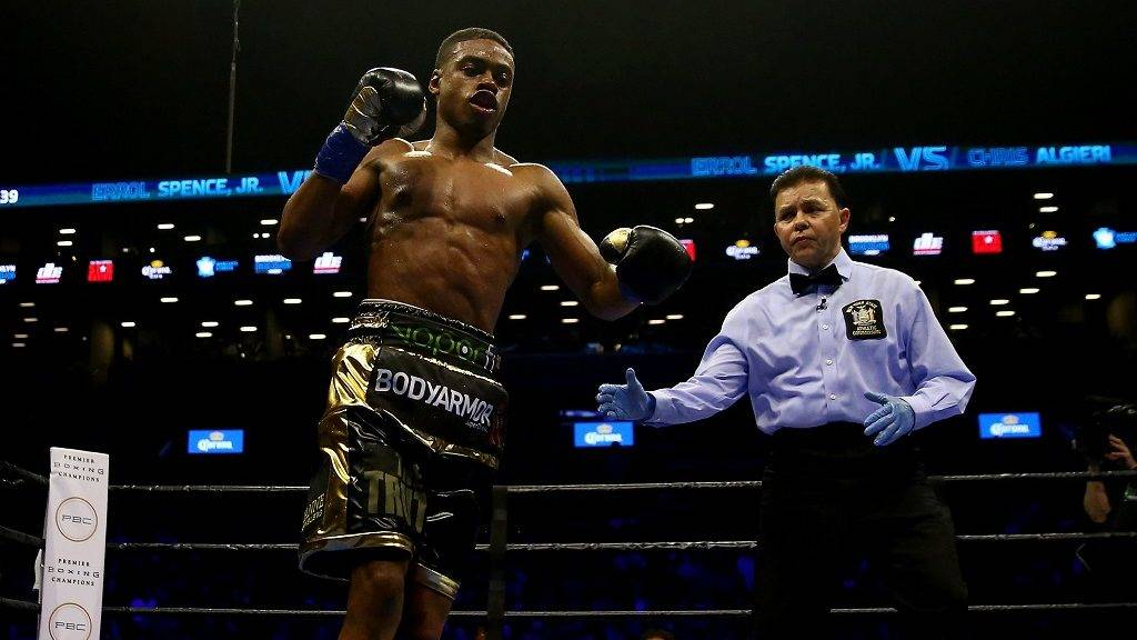 NEW YORK, NY - APRIL 16: Errol Spence Jr. celebrates in the fourth round after he knocked down Chris Algieri during their welterwieght bout at Barclays Center on April 16, 2016 in the Brooklyn borough of New York City.Spence Jr. knocked out Algieri in the fifth round.   Elsa/Getty Images/AFP
