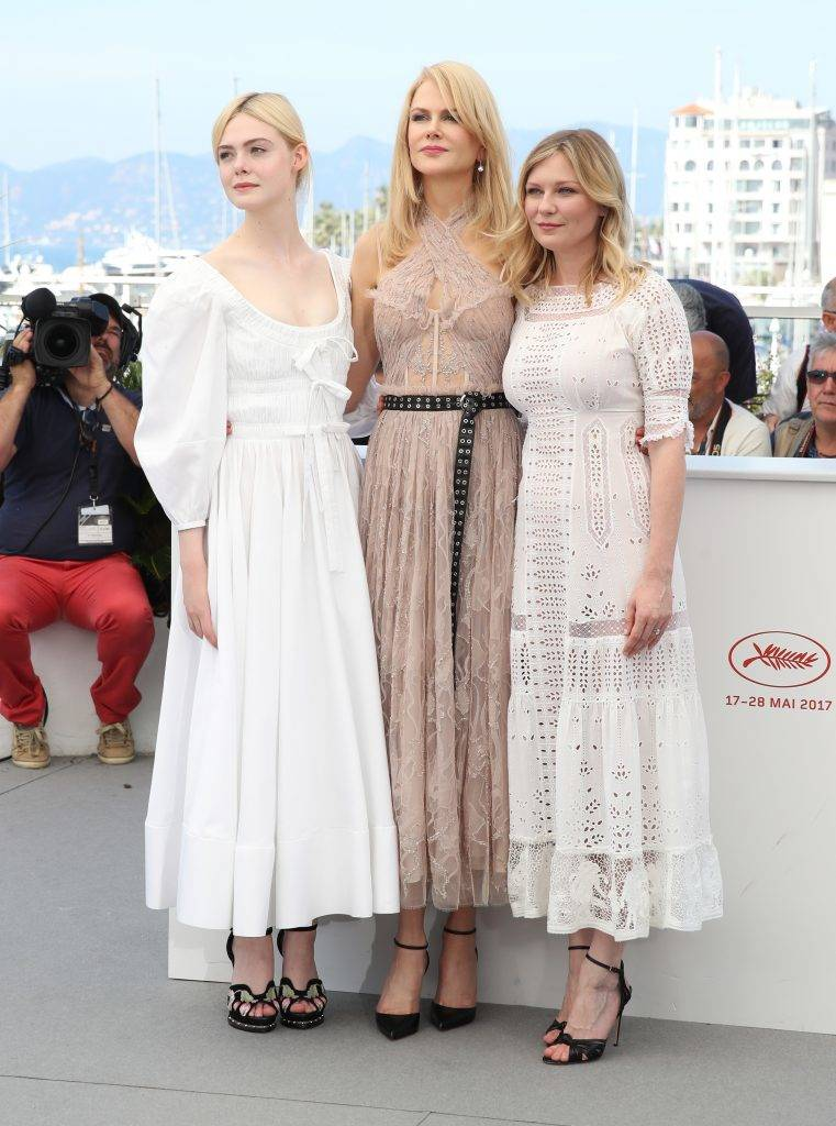 """CANNES, FRANCE - MAY 24:  Actresses Elle Fanning, Nicole Kidman and Kirsten Dunst attend """"The Beguiled"""" photocall during the 70th annual Cannes Film Festival at Palais des Festivals on May 24, 2017 in Cannes, France.  (Photo by Chris Jackson/Getty Images)"""