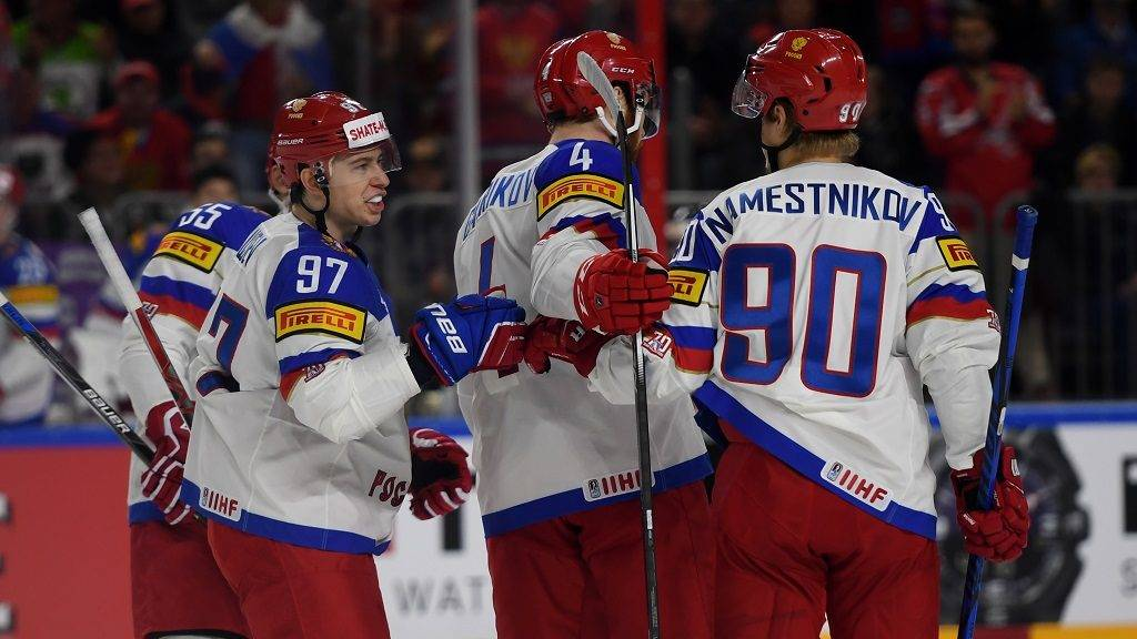 Russia´s players react after scoring during IIHF Ice hockey world championship first round match between Russia and Italy in the LANXESS arena in Cologneon May 7, 2017. / AFP PHOTO / PATRIK STOLLARZ