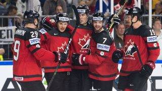 Canada's Matt Duchene (left to right), scorer Jeff Skinner, Mark Scheifele, Josh Morrissey and Mike Matheson celebrate after the 2:0 during the Ice Hockey World Championship quarter-final match between Canada and Germany in the Lanxess Arena in Cologne, Germany, 18 May 2017. Photo: Marius Becker/dpa
