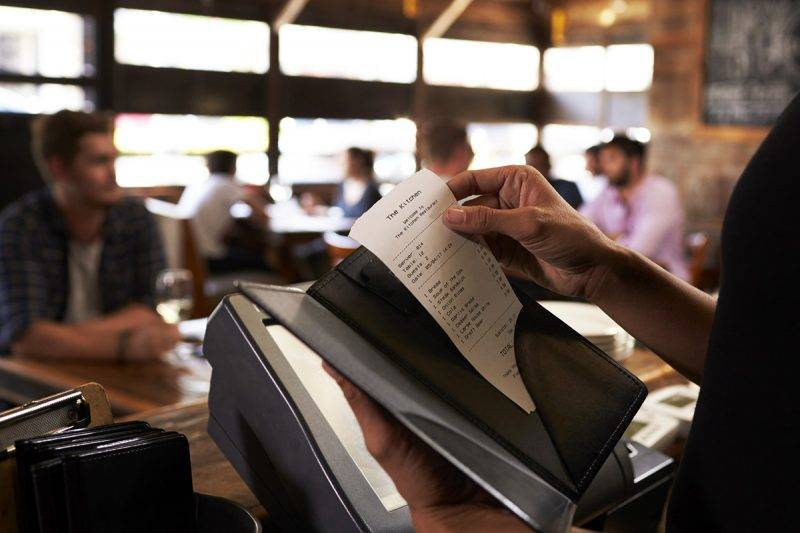 Preparing the bill at a restaurant to be taken to a table
