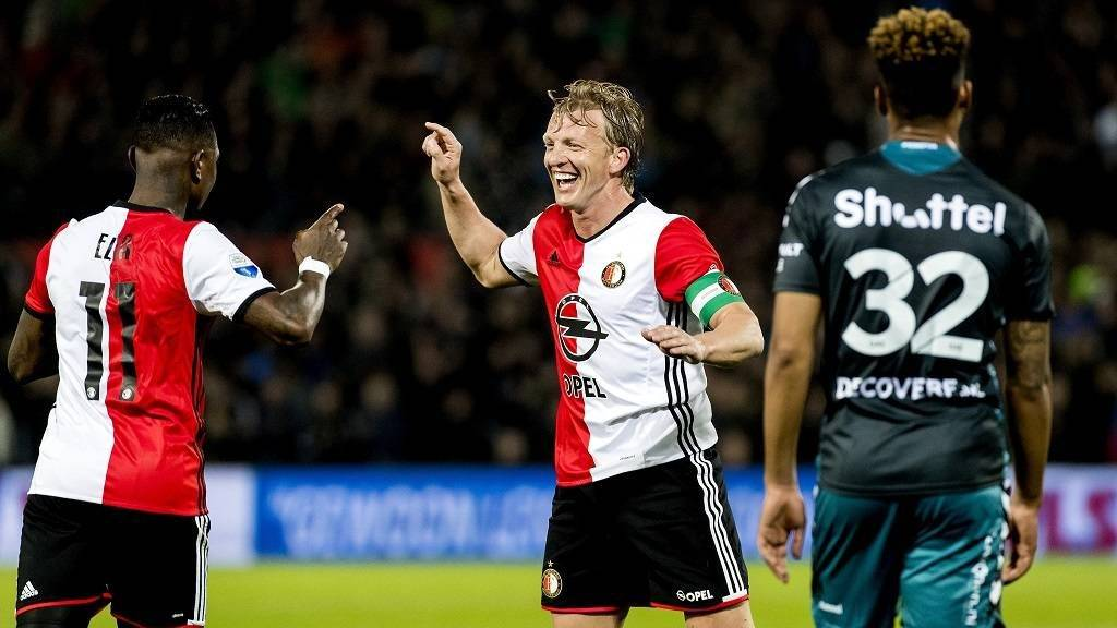Dirk Kuyt of Feyenoord Rotterdam celebrates the 3-0 score with his teammates during the Dutch Eredivisie soccer match in Rotterdam on April 5, 2017.  / AFP PHOTO / ANP / Koen van Weel / Netherlands OUT