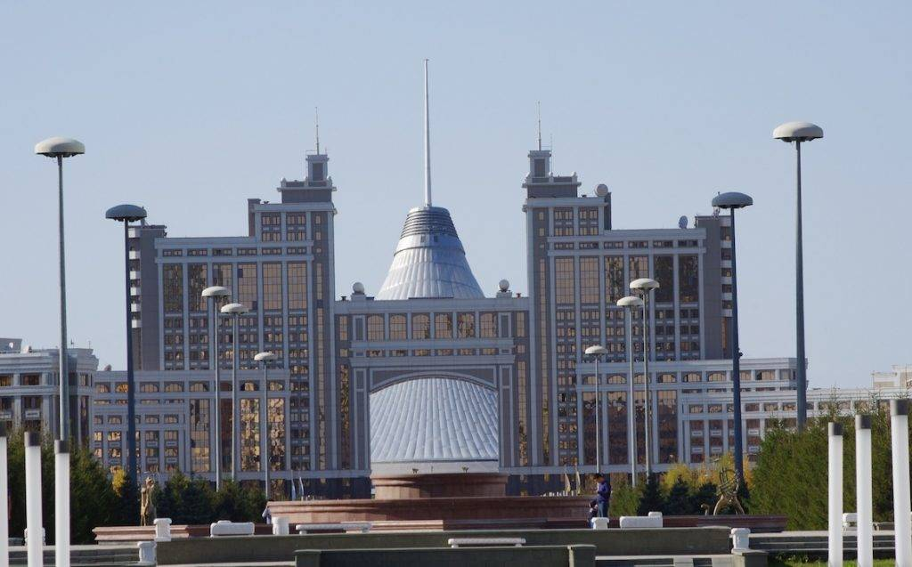 The nearer building with the arch houses  the national oil and gas company of Kazakhstan while the huge pyramid-shaped tent (sort of like a giant teepee) in the back is the Khan Shatir (Great Tent) shopping mall.