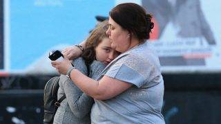 MANCHESTER, UNITED KINGDOM - MAY 23: Walking casualties Vikki Baker and her thirteen year old daughter Charlotte hug outside the Manchester Arena stadium in Manchester, United Kingdom on May 23, 2017. A large explosion was reported at the end of a concert by American singer Ariana Grande. So far, police have confirmed 20 dead and over fifty injured in the explosion, now thought to be terrorist-related.  Lindsey Parnaby / Anadolu Agency
