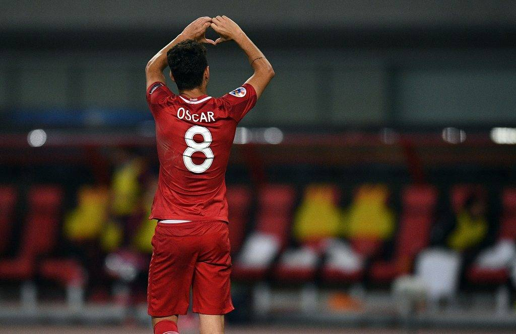 Shanghai SIPG' Brazilian midfielder Oscar celebrates after scoring  during the AFC Asian Champions League group match between the Shanghai SIPG and South Korea's FC Seoul in Shanghai on April 26, 2017.  / AFP PHOTO / Johannes EISELE