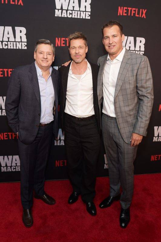 """NEW YORK, NY - MAY 16: (L-R) Chief Content Officer for Netflix Ted Sarandos, actor Brad Pitt, and Vice President of Original Film for Netflix Scott Stuber attend a special screening of the Netflix original film """"War Machine"""" at The Metrograph on May 16, 2017 in New York City.   Jason Kempin/Getty Images for Netflix/AFP"""