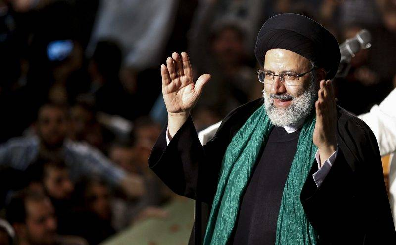 Iranian presidential candidate Ebrahim Raisi greets his supporters during a campaign rally at Imam Khomeini Mosque in the capital Tehran on May 16, 2017.