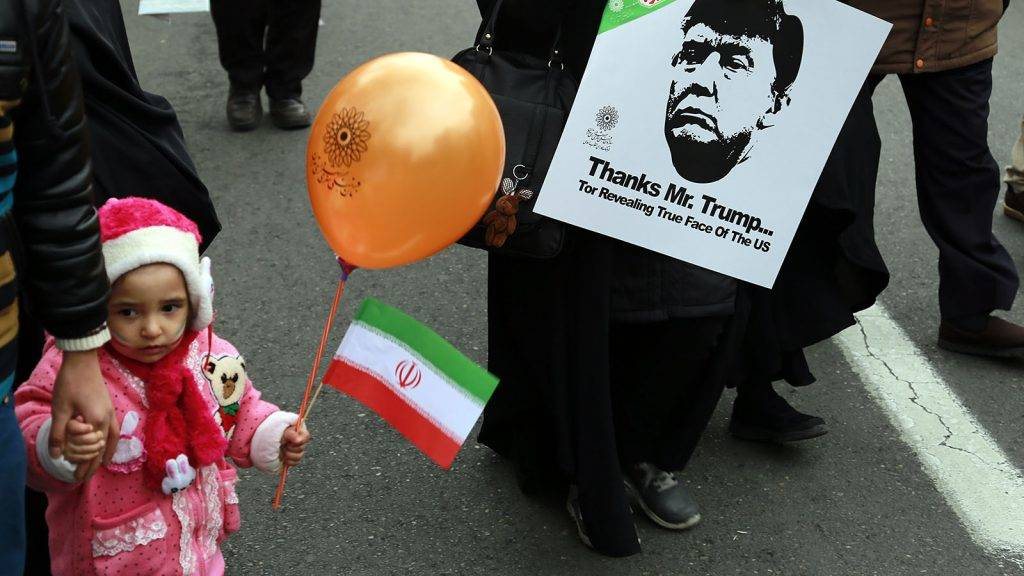 IRAN, Tehran: A participant holds a sign with the picture of US president Donald Trump and words Thanks Mr. Trump for revealing true face of the US as Iranians take part in a rally marking the anniversary of the 1979 Islamic revolution on February 10, 2017, in the capital Tehran. Millions of Iranians marched on the anniversary day around the nation in what President Hassan Rouhani described as a response to the new US administration -- a rejection of threatening language. - Rouzbeh Fouladi