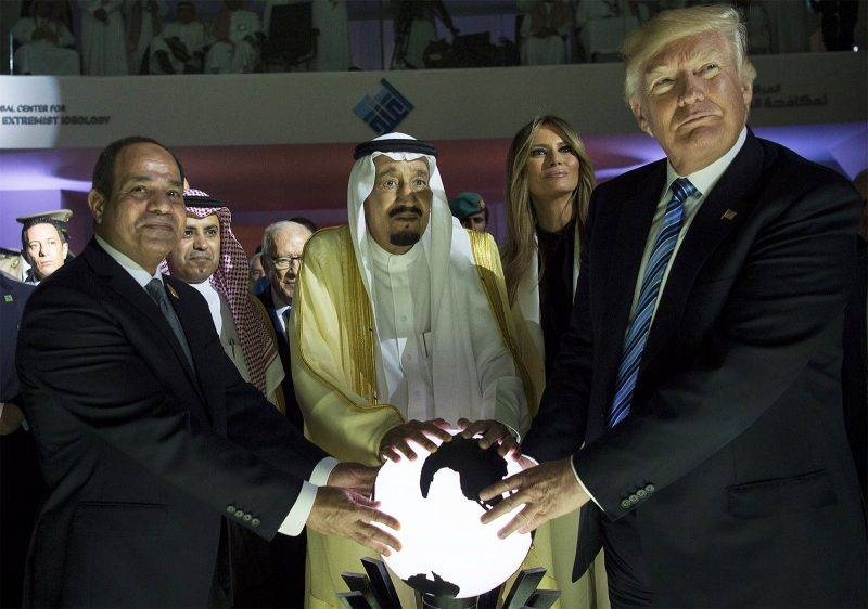 """RIYADH, SAUDI ARABIA - MAY 21: (----EDITORIAL USE ONLY – MANDATORY CREDIT - """"BANDAR ALGALOUD / SAUDI ROYAL COUNCIL / HANDOUT"""" - NO MARKETING NO ADVERTISING CAMPAIGNS - DISTRIBUTED AS A SERVICE TO CLIENTS----)US President Donald Trump, US First lady Melania Trump (2nd R), Saudi Arabia's King Salman bin Abdulaziz al-Saud (2nd L) and Egyptian President Abdel Fattah el-Sisi (L) put their hands on an illuminated globe  during the inauguration ceremony of the Global Center for Combating Extremist Ideology in Riyadh, Saudi Arabia on May 21, 2017. Bandar Algaloud / Saudi Royal Council / Handout / Anadolu Agency"""