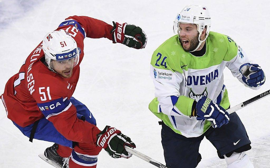 Norway's forward Mats Rosseli Olsen (L) vies with Slovenia's defender Luka Vidmar during the IIHF Men's World Championship group B ice hockey match between Slovenia and Norway on May 9, 2017 in Paris. / AFP PHOTO / FRANCK FIFE