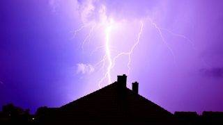 66035608 - dramatic sky and storm. lightning hit the house. power of nature concept.