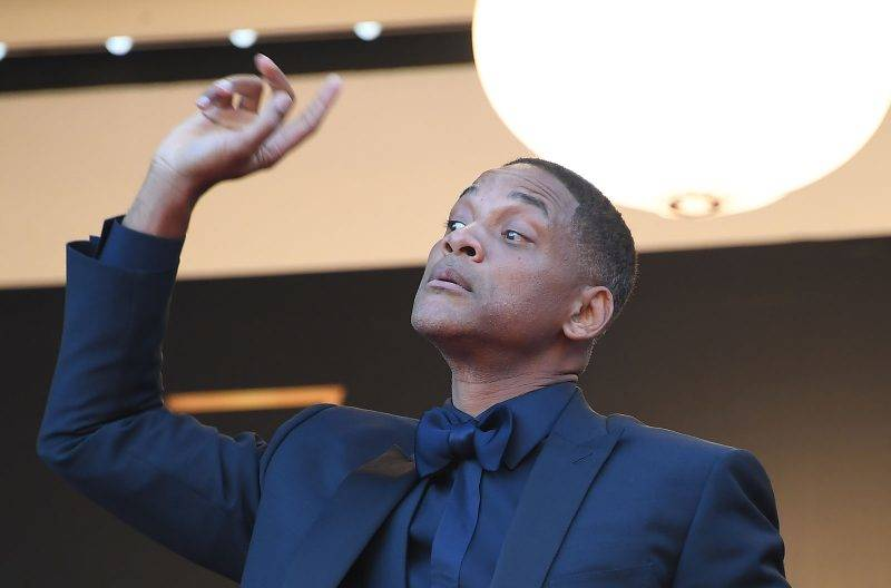 US actor and member of the Feature Film jury Will Smith gestures as he arrives on May 23, 2017 for the '70th Anniversary' ceremony of the Cannes Film Festival in Cannes, southern France.  / AFP PHOTO / Anne-Christine POUJOULAT