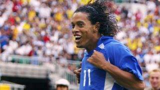 Brazilian midfielder Ronaldinho jubilates after he scored his team's second goal during the England/Brazil quarterfinal match of the FIFA 2002 Soccer World Cup, 21 June 2002 at Shizuoka Stadium Ecopa.  AFP PHOTO ANTONIO SCORZA / AFP PHOTO / ANTONIO SCORZA