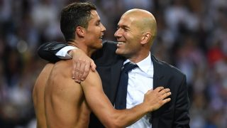Real Madrid's Portuguese forward Cristiano Ronaldo (L) and Real Madrid's French coach Zinedine Zidane celebrate after Real Madrid won the UEFA Champions League final football match over Atletico Madrid at San Siro Stadium in Milan, on May 28, 2016. / AFP PHOTO / GERARD JULIEN