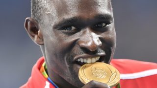Gold medallist Kenya's David Lekuta Rudisha celebrates on the podium for the Men's 800 meter during the athletics at the Rio 2016 Olympic Games at the Olympic Stadium in Rio de Janeiro on August 16, 2016.   / AFP PHOTO / Fabrice COFFRINI