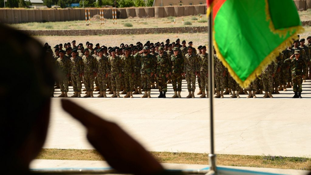 Afghan National Army (ANA) soldiers stand to attention during a ceremony for the completion of their training at a military base in Herat on May 29, 2017.  Around 800 soldiers trained for 10 weeks during the ANA training progam, after which they are sent on assignments throughout the restive country. / AFP PHOTO / HOSHANG HASHIMI