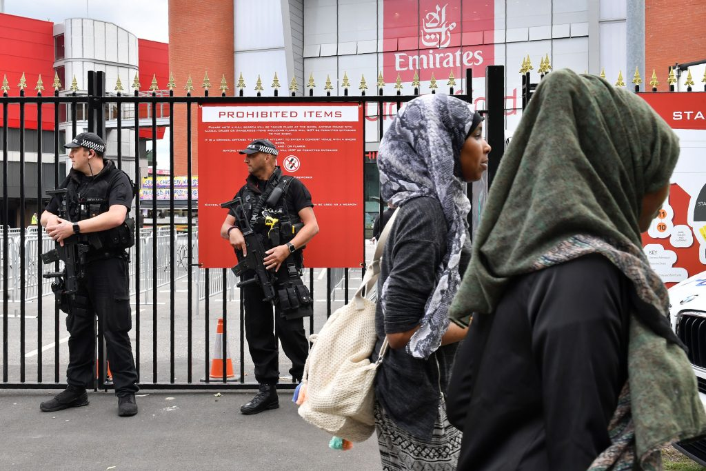 Armed police officers patrol outside the Old Trafford Cricket Ground ahead of the One Love Manchester tribute concert in Manchester on June 4, 2017. Nearly two weeks after a deadly suicide bombing at her concert in Manchester, US star Ariana Grande is planning to press ahead with a charity gig later on June 4, despite a terror attack on the streets of London. / AFP PHOTO / Anthony Devlin