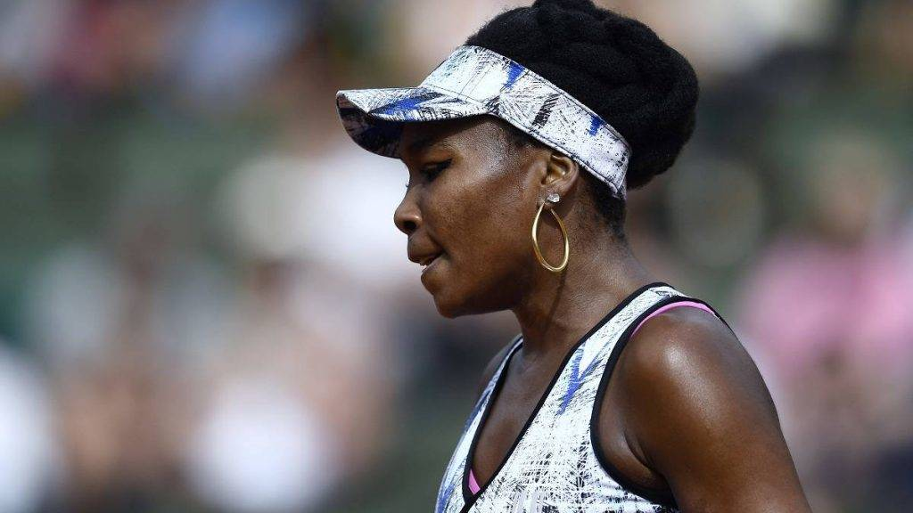 """US Venus Williams reacts after a point against Switzerland's Timea Bacsinszky during their tennis match at the Roland Garros 2017 French Open on June 4, 2017 in Paris.  / AFP PHOTO / CHRISTOPHE SIMON / """"The erroneous mentions appearing in the metadata of these photos by Christophe SIMON have been modified in AFP systems in the following manner: [US Venis Williams plays against Switzerland's Timea Bacsinszky on June 4, 2017] instead of [US Venis Williams plays against Belgium's Elise Mertens on June 2, 2017]. Please immediately remove the erroneous mention[s] from all your online services and delete them from your servers. If you have been authorized by AFP to distribute them to third parties, please ensure that the same actions are carried out by them. Failure to promptly comply with these instructions will entail liability on your part for any continued or post notification usage. Therefore we thank you very much for all your attention and prompt action. We are sorry for the inconvenience this notification may cause and remain at your disposal for any further information you may require."""""""