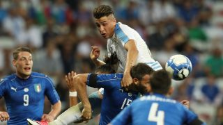Uruguay's defender Jose Gimenez (top) vies with Italy's defender Andrea Barzagli during the friendly football match Italy vs Uruguay at the Allianz Riviera Stadium in Nice, southern France, on June 7, 2017. / AFP PHOTO / VALERY HACHE