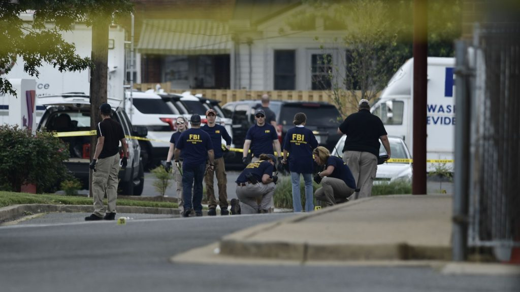 Members of the FBI inspect the crime scene after a shooting during a practice of the Republican congressional baseball at Eugene Simpson Statium Park June 14, 2017 in Alexandria, Virginia. At least five people people including a top Republican congressman were wounded in a Washington suburb early Wednesday morning when a shooting erupted as they practiced for an annual baseball game between lawmakers. Senior congressman Steve Scalise was shot in the hip, according to fellow Republican lawmaker Mo Brooks who told CNN at least two law enforcement officers and one congressional staffer were also shot in the incident in Alexandria, Virginia.  / AFP PHOTO / Brendan Smialowski