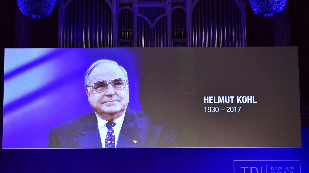 President of the Federation of German Industry (BDI) Dieter Kempf respects a minute of silence to commemorate late German former Chancellor Helmut Kohl at a two-day meeting of the Federation of German Industry (BDI) on June 20, 2017 in Berlin.   / AFP PHOTO / TOBIAS SCHWARZ