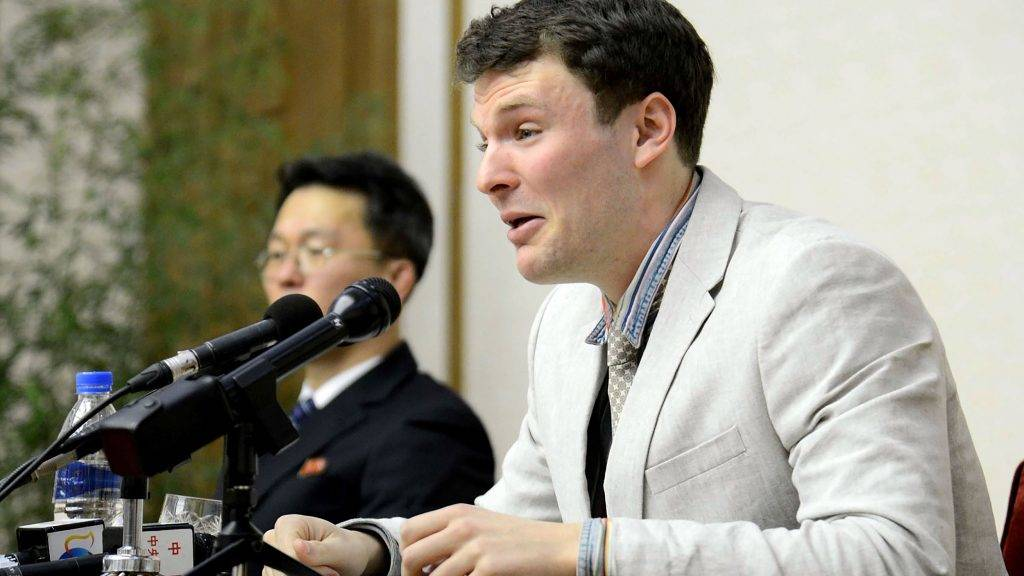 """(FILES) This file photo taken on February 29, 2016 and released by North Korea's official Korean Central News Agency (KCNA) on March 1, 2016 shows US student Otto Frederick Warmbier (R), who was arrested for committing hostile acts against North Korea, speaking at a press conference in Pyongyang.   South Korean President Moon Jae-In said June 20, 2017 that North Korea bears responsibility for the death of US student Otto Warmbier, and described its regime as irrational.Ahead of talks here next week with President Donald Trump, Moon said he hopes to engage North Korea in dialogue by the end of the year.  / AFP PHOTO / KCNA / Handout / North Korea OUT / REPUBLIC OF KOREA OUT --- RESTRICTED TO EDITORIAL USE - MANDATORY CREDIT """"AFP PHOTO / KCNA VIA KNS"""" - NO MARKETING NO ADVERTISING CAMPAIGNS - DISTRIBUTED AS A SERVICE TO CLIENTS  THIS PICTURE WAS MADE AVAILABLE BY A THIRD PARTY. AFP CAN NOT INDEPENDENTLY VERIFY THE AUTHENTICITY, LOCATION, DATE AND CONTENT OF THIS IMAGE. THIS PHOTO IS DISTRIBUTED EXACTLY AS RECEIVED BY AFP. ---EDITORS NOTE--- RESTRICTED TO EDITORIAL USE - MANDATORY CREDIT """"AFP PHOTO/KCNA VIA KNS"""" - NO MARKETING NO ADVERTISING CAMPAIGNS - DISTRIBUTED AS A SERVICE TO CLIENTS"""