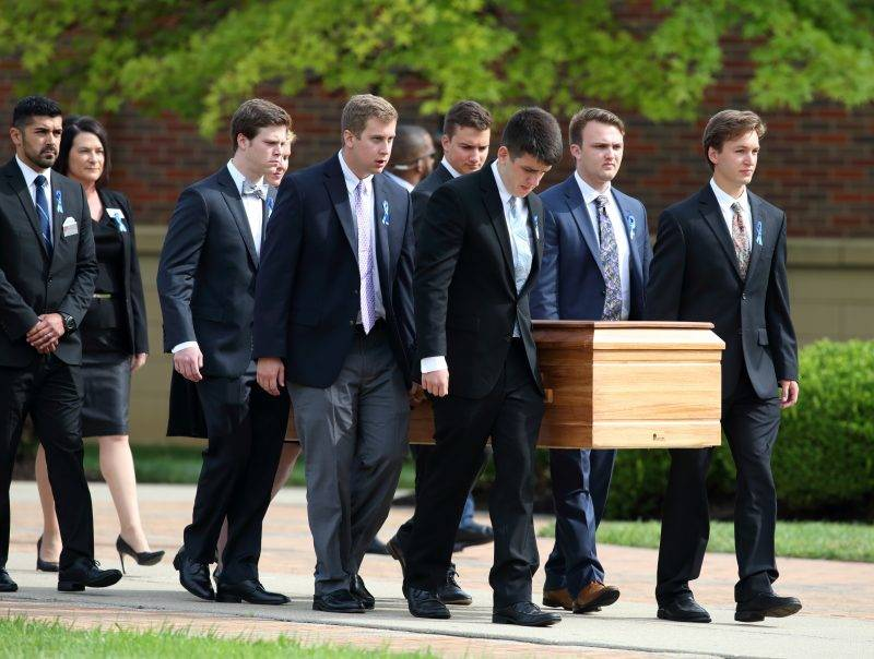 The casket carrying the remains of Otto Warmbier is carried out of  Wyoming High School in Wyoming, Ohio on June 22, 2017, following the funeral for Otto Warmbier.  Warmbier an American university student who, while visiting North Korea as a tourist in January 2016, was arrested and sentenced to 15 years of hard labor after being accused of stealing a propaganda poster. Warmbier died on June 19, 2017 six days after retuning to the United States in a coma.  / AFP PHOTO / Paul Vernon