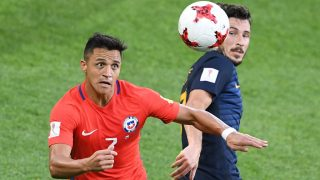 Australia's forward Mathew Leckie (L) vies with Chile's forward Alexis Sanchez during the 2017 Confederations Cup group B football match between Chile and Australia at the Spartak Stadium in Moscow on June 25, 2017.  / AFP PHOTO / Natalia KOLESNIKOVA