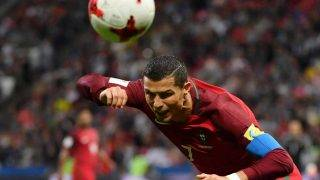 Portugal's forward Cristiano Ronaldo heads the ball during the 2017 Confederations Cup semi-final football match between Portugal and Chile at the Kazan Arena in Kazan on June 28, 2017. / AFP PHOTO / Yuri CORTEZ