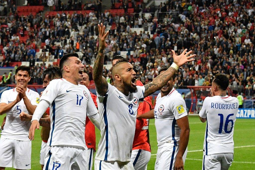 Chile's midfielder Arturo Vidal reacts as Chile goes into the finals of the 2017 Confederations Cup semi-final football match after beating Portugal in a penelty shoot out at the Kazan Arena in Kazan on June 28, 2017. / AFP PHOTO / Alexander NEMENOV