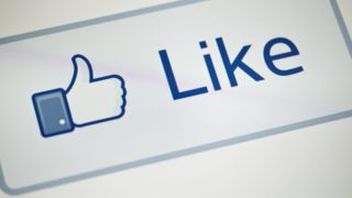 """A view of Facebook's """"Like"""" button May 10, 2012 in Washington, DC.  Social-networking giant Facebook will go public on the NASDAQ May 18 with its initial public offering, trading under the symbol FB, in an effort to raise $10.6 billion. / AFP PHOTO / BRENDAN SMIALOWSKI"""