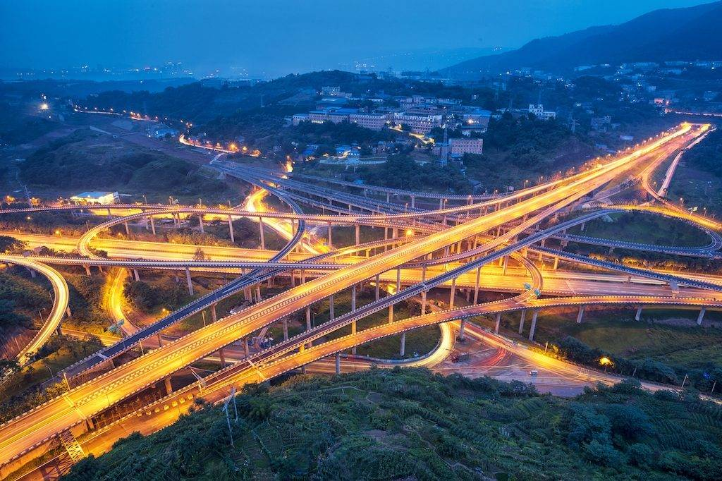 Aerial view of the five-level Huangjuewan Overpass at night in the Nan'an District of Chongqing, China, 24 June 2017.  The five-level Huangjuewan overpass was erected in the Nan'an District of Chongqing, southwest China. The newly-built overpass consists of 15 ramps with a total length of 16,414 meters.