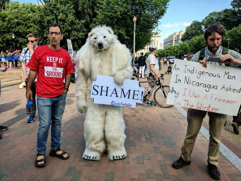 UNITED STATES, Washington DC: Environmental activists and supporters display placards during a demonstration outside th White House in Washington DC on June 1, 2017, to protest US President Donald Trump's decision to pull out of the 195-nation Paris climate accord deal. US President Donald Trump earlier announced America is getting out of a deal he said imposed draconian burdens that would cost the US millions of jobs and billions in cold hard cash. - Patrick Irelan