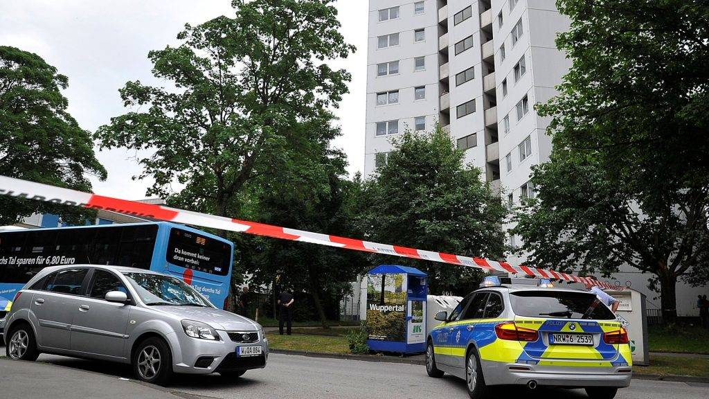 A police car parked in front of a high-rise building in Wuppertal, Germany, 27 June 2017. The high-rise was cleared of people two weeks after a devastating fire at a high-rise in London left at least 79 dead.A spokeswoman for the city stated that this short-notice measure was taken because the building's facade insulation resembled that in use at London's Grenfell Tower. Photo: Holger Battefeld/dpa