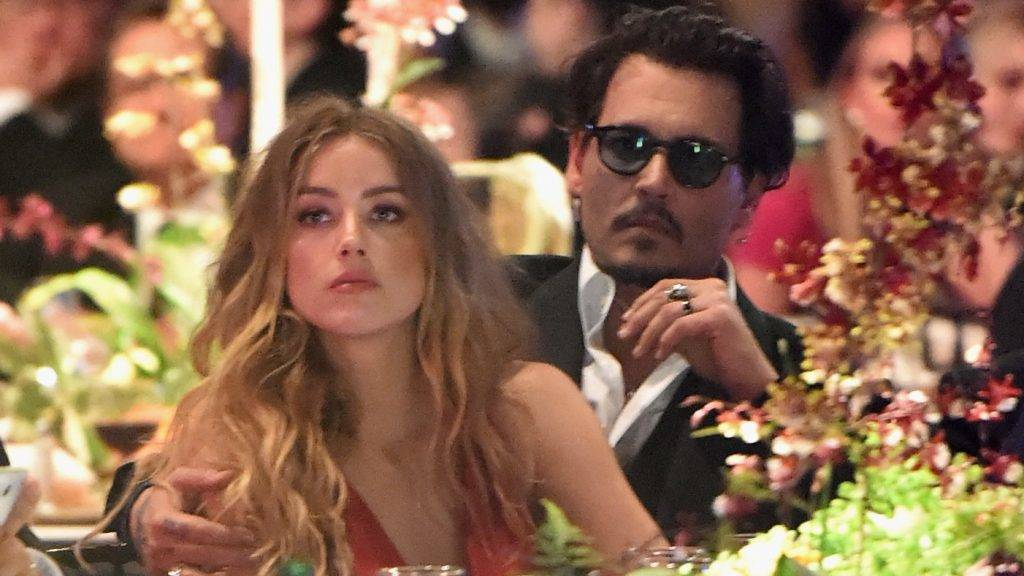 CULVER CITY, CA - JANUARY 09: Actors Amber Heard and Johnny Depp attend The Art of Elysium 2016 HEAVEN Gala presented by Vivienne Westwood & Andreas Kronthaler at 3LABS on January 9, 2016 in Culver City, California.   Jason Merritt/Getty Images for Art of Elysium/AFP