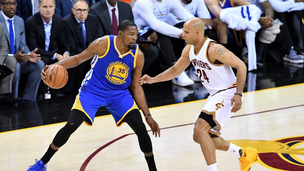 CLEVELAND, OH - JUNE 07: Kevin Durant #35 of the Golden State Warriors handles the ball against Richard Jefferson #24 of the Cleveland Cavaliers in the first half in Game 3 of the 2017 NBA Finals at Quicken Loans Arena on June 7, 2017 in Cleveland, Ohio. NOTE TO USER: User expressly acknowledges and agrees that, by downloading and or using this photograph, User is consenting to the terms and conditions of the Getty Images License Agreement.   Jason Miller/Getty Images/AFP