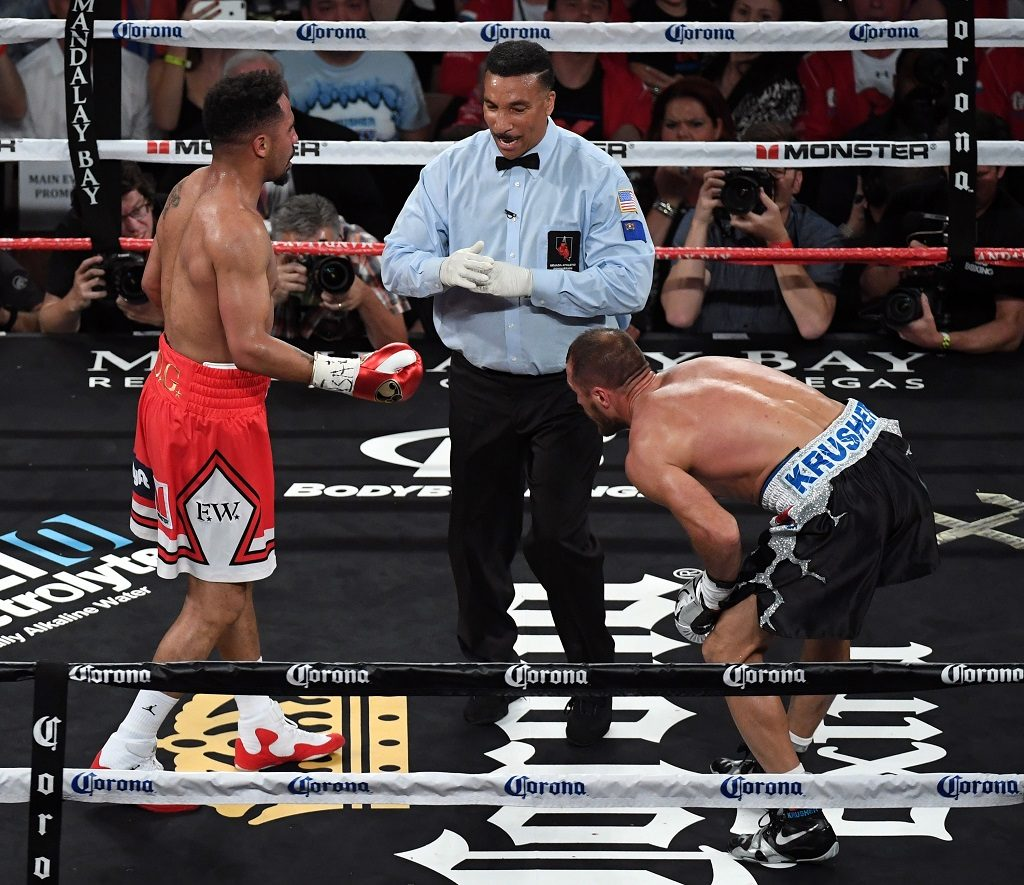 LAS VEGAS, NV - JUNE 17: Referee Tony Weeks (C) calls timeout after Andre Ward (L) apparently hit Sergey Kovalev (R) with a low blow in the second round of their light heavyweight championship bout at the Mandalay Bay Events Center on June 17, 2017 in Las Vegas, Nevada. Ward retained his WBA/IBF/WBO titles with a TKO in the eighth round.   Ethan Miller/Getty Images/AFP