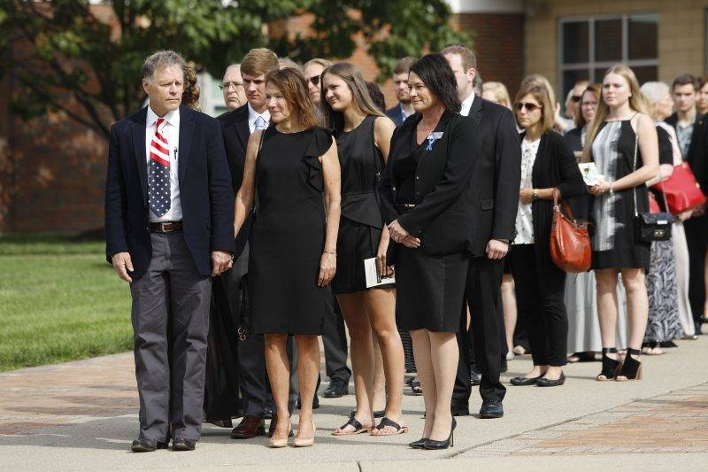 WYOMING, OH - JUNE 22: Fred and Cindy Warmbier watch as the casket of their son Otto Warmbier is carried out from his funeral at Wyoming High School June 22, 2017 in Wyoming, Ohio. Otto Warmbier, the 22-year-old college student who was released from a North Korean prison last Tuesday after spending 17 months in captivity for allegedly stealing a propaganda poster, died Monday, June 19th in a Cincinnati hospital, after having been in a coma.   Bill Pugliano/Getty Images/AFP