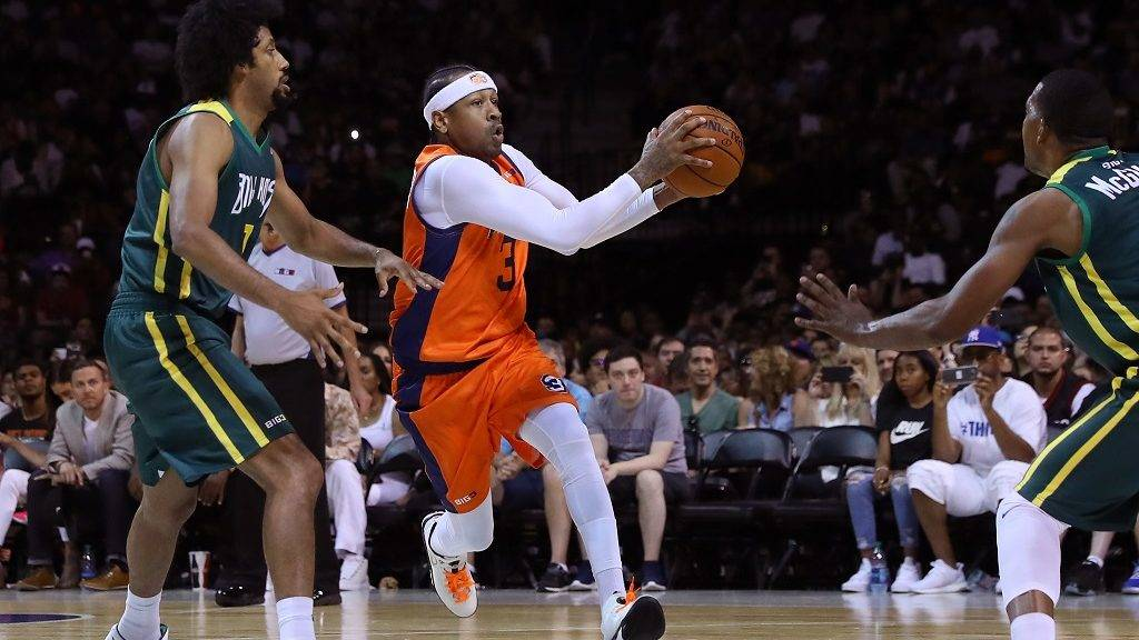 NEW YORK, NY - JUNE 25: Allen Iverson #3 of 3's Company drives with the ball against Josh Childress #7 of the Ball Hogs during week one of the BIG3 three on three basketball league at Barclays Center on June 25, 2017 in New York City.   Mike Stobe/Getty Images/AFP