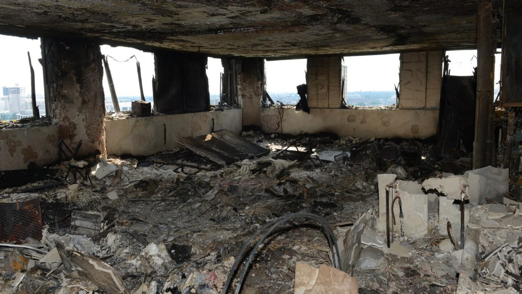 "LONDON, UNITED KINGDOM - JUNE 18: (----EDITORIAL USE ONLY – MANDATORY CREDIT - "" LONDON METROPOLITAN POLICE SERVICE"" - NO MARKETING NO ADVERTISING CAMPAIGNS - DISTRIBUTED AS A SERVICE TO CLIENTS----) An undated handout photo made available by Britain's London Metropolitan Police Service (MPS) on 18 June 2017 shows a view on a burned flat inside the Grenfell Tower, a 24-storey apartment block in North Kensington, West London, United Kingdom. Police investigates the fire at the Grenfell Tower that broke out on 14 June 2017. At least 58 people are now missing and presumed dead in the Grenfell Tower disaster, police have said. This latest figure includes the 30 already confirmed to have died in the fire.The cause of the fire is yet not known.
