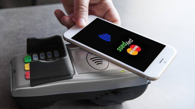 CONTACTLESS PAYMENT  Woman paying with mobile phone.   AMELIE-BENOIST / BSIP