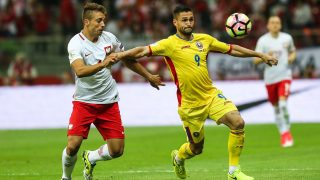 Thiago Cionek (POL), Florin Andone (ROM)  vie for the ball during the FIFA World Cup 2018 qualification football match between Poland and Romania in Warsaw, Poland on June 10, 2017. (Photo by Foto Olimpik/NurPhoto)