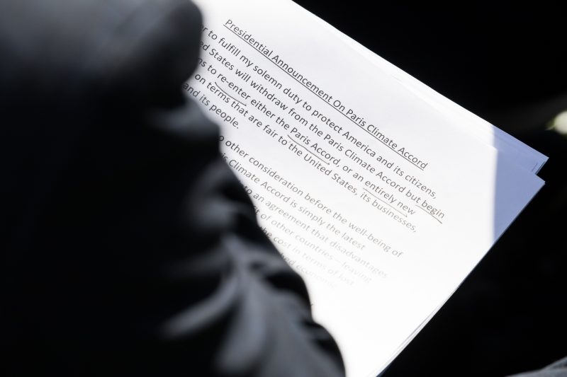 A White House staffer holds the speech President Trump delivered in which he stated that the United States is withdrawing from the Paris Climate Accord, in the Rose Garden of the White House, On Thursday, June 1, 2017. (Photo by Cheriss May) (Photo by Cheriss May/NurPhoto)