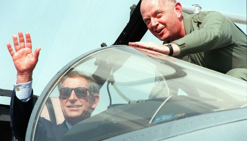 Britain's Prince Charles waves from the cockpit of a Eurofighter 18 November 1999, at the Dubai air show. The prototype Eurofighter tycoon, made by a British led consortium, is one display among scores by some 30 British exhibitors at the massive air show, where Britain is the largest foreign participant. / AFP PHOTO