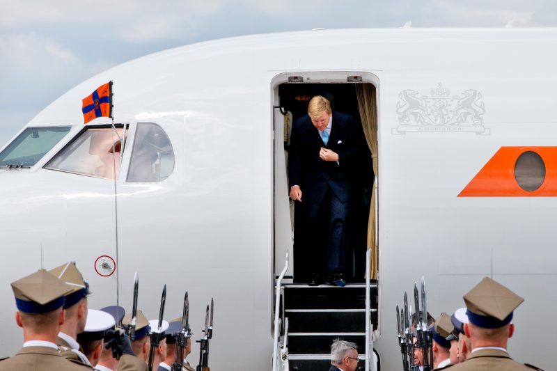 Dutch King Willem-Alexander and Queen Maxima (unseen) arrive in a Fokker 70 PH KBX government's plane at the airport Frederic Chopin in Warsaw, Poland, 24 June 2014 for their first state visit from 24 to 25 June. Photo: Patrick van Katwijk / NETHERLANDS AND FRANCE; OUT -NO WIRE SERVICE-