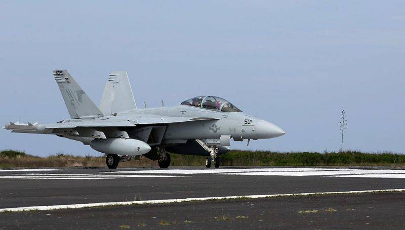 IWOJIMA, TOKYO, JAPAN - MAY 14:  U.S. Navy EA-18 Growler take off during the Field Carrier Landing Practice of the Carrier Air Wing 5 of U.S. Naval Air Facility Atsugi on May 14, 2014 in Iwojima, Tokyo, Japan. The Iwo Jima Island is the setting of World War II Battle of Iwo Jima between the United States and Japan in 1945. Civilian access to the island is restricted to memorial attendees, workers for the naval air base, and meteorological agency officials.  (Photo by Ken Ishii/Getty Images)