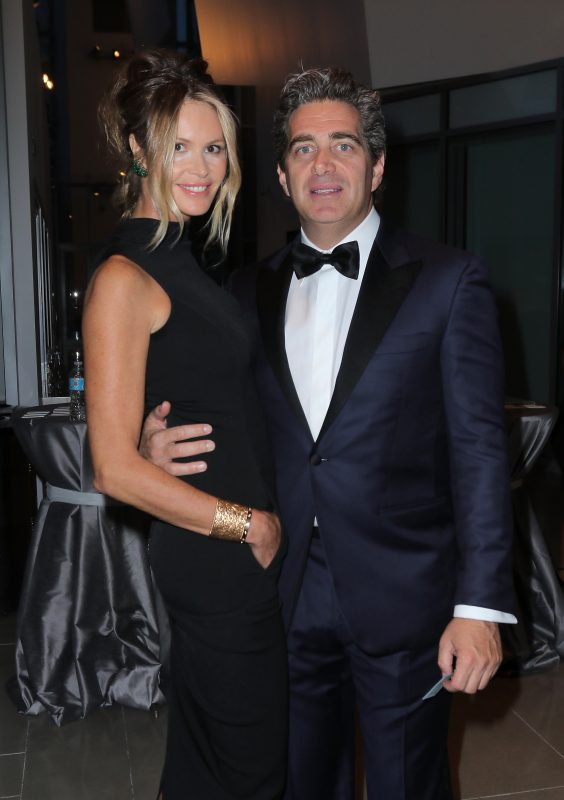 MIAMI BEACH, FL - MAY 15:  Elle McPherson (L) and Jeffrey Soffer during Pritzker Architecture Prize 2015 at New World Symphony on May 15, 2015 in Miami Beach, Florida.  (Photo by John Parra/Getty Images for Pritzker Architecture Prize)